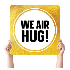Gold Dot Air Hug Handheld sign